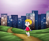A young boy playing across the tall buildings in the city Royalty Free Stock Image