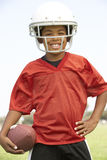 Young Boy Playing American Football. Smiling stock photo