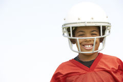 Young Boy Playing American Football. Smiling stock photos
