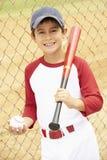 Young Boy Playing Baseball. Holding Bat and Ball Smiling Royalty Free Stock Photo