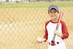 Young Boy Playing Baseball. Holding Bat and Ball Smiling Royalty Free Stock Photos