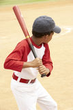 Young Boy Playing Baseball. Young African American Boy Playing Baseball royalty free stock image