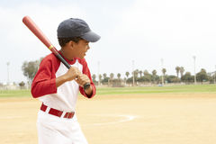 Young Boy Playing Baseball. Young African American Boy Playing Baseball stock image
