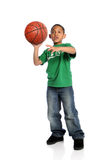 Young Boy Playing Basketball. Young African American boy playing basketball isolated over white background Royalty Free Stock Image