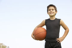 Young Boy Playing Basketball Royalty Free Stock Images