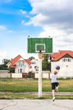 Young boy playing basketball alone Royalty Free Stock Photo