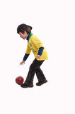 Young boy playing basketball. On white Royalty Free Stock Images