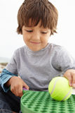Young boy playing with bat and ball Royalty Free Stock Photography