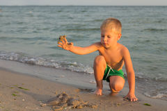 A young boy playing on the beach Stock Photo