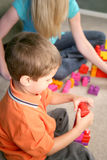 A young boy playing with blocks Royalty Free Stock Photography