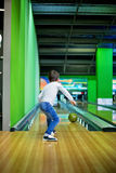 Young boy, playing bowling indoors. Young boy, playing bowling for the first time, indoors royalty free stock photography