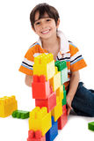 Young boy playing with building blocks Royalty Free Stock Photos