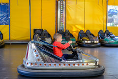 Young boy playing in a bumper car Royalty Free Stock Image