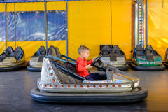 Young boy playing in a bumper car Royalty Free Stock Photos