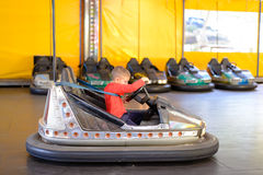 Young boy playing in a bumper car Stock Photo