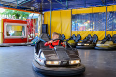 Young boy playing in a bumper car Stock Photography