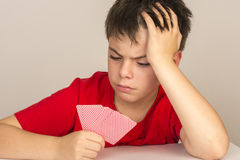 Young boy playing cards Stock Photography