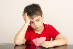 Young boy playing cards Royalty Free Stock Images