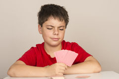 Young boy playing cards Stock Image