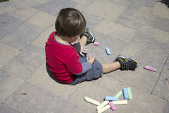 Young Boy Playing with Chalk Royalty Free Stock Photography