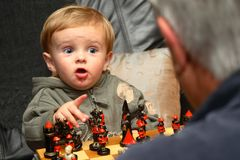 Young boy playing chess Royalty Free Stock Images
