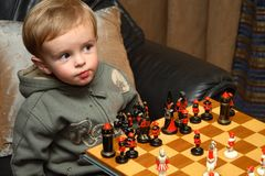 Young boy playing chess stock photography