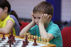 Young boy playing chess Royalty Free Stock Photography