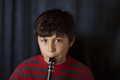 Young boy playing the clarinet Royalty Free Stock Image