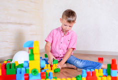 Young boy playing with colorful building blocks Stock Photography