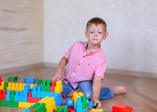 Young boy playing with colorful building blocks Royalty Free Stock Photo