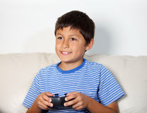 Young boy playing computer game Stock Photo