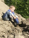 Young boy playing in the dirt Royalty Free Stock Photography