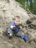 Young boy playing in the dirt Royalty Free Stock Images