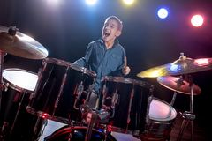 Young boy playing drums Stock Images