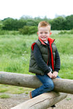 Young boy playing in the fields. A young boy having fun in the countryside Royalty Free Stock Photo