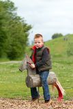Young boy playing in the fields. A young boy having fun in the countryside Stock Photography