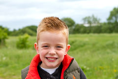 Young boy playing in the fields Stock Image