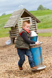 Young boy playing in the fields. A young boy having fun in the countryside Stock Photo