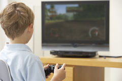 Young Boy Playing With Game Console. At Home Stock Photo