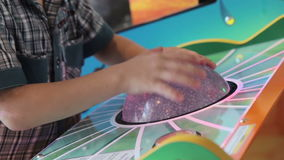 A young boy playing game machine. HD stock video footage