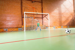 Young boy playing goal keeper for his friends Royalty Free Stock Image