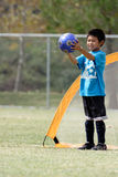 Young boy playing goalie in soccer. Preparing for a big kick Royalty Free Stock Photography