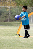 Young boy playing goalie in soccer. Young boy in soccer Royalty Free Stock Images