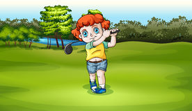 A young boy playing golf at the field Stock Images