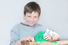 Young boy playing green construction Royalty Free Stock Photo