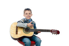 A young boy playing guitar Royalty Free Stock Images