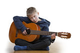 Young boy playing guitar Stock Images
