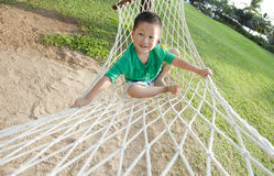 Young boy playing happy in beach hammock Royalty Free Stock Image