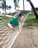 Young boy playing happy in beach hammock Stock Images