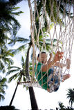 Young boy playing happy in beach hammock Stock Photos